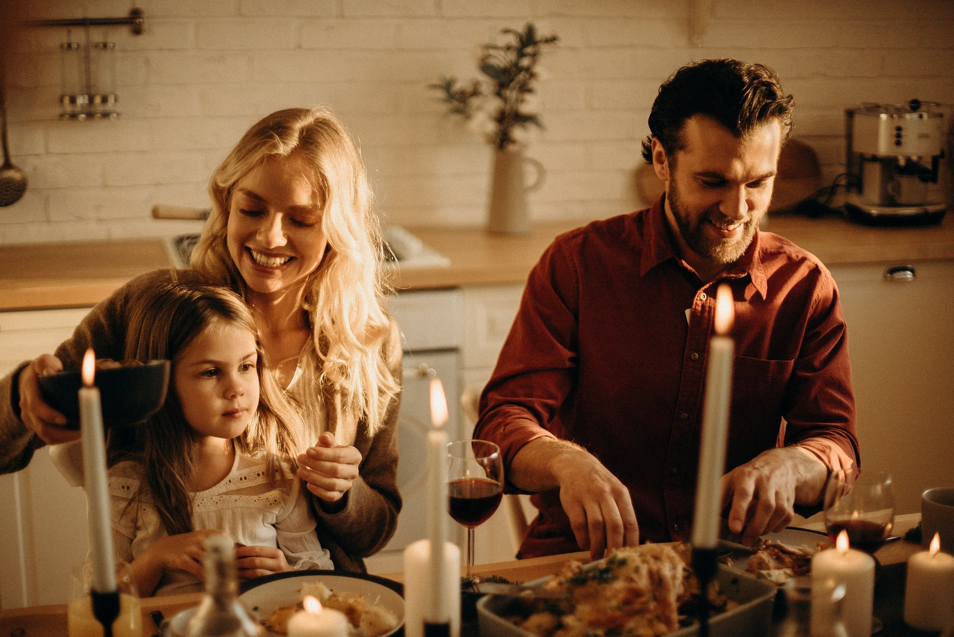 Family At New Years Table Smiling Being Thankful